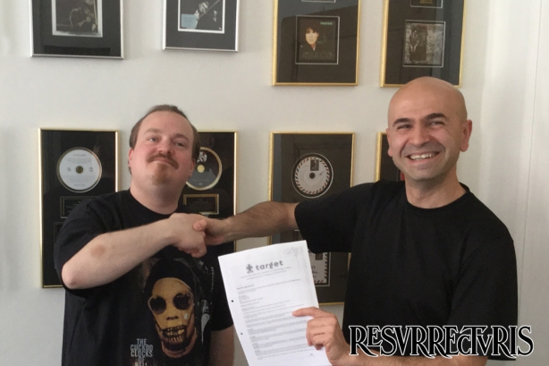 Peter Mesnickow (Mighty Music/Target) and Carlo Strappa (Resurrecturis) holding a signed copy of the contract!